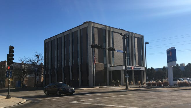Tower Clock Eye Center partners have purchased the BMO Harris building at the corner of Walnut Street and Broadway.