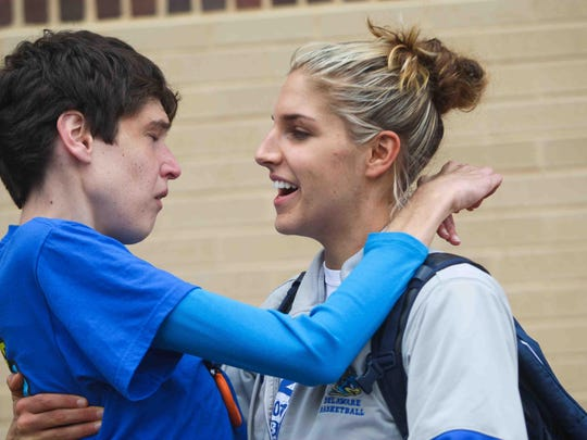 Elena Delle Donne greets her sister, Lizzie, as the University of Delaware women's basketball team returns to the Bob Carpenter Center after the team's season ended in the NCAA tournament in March 2012.