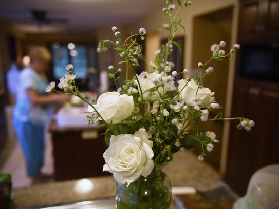 Flowers decorate the kitchen area of the Quiet Oaks