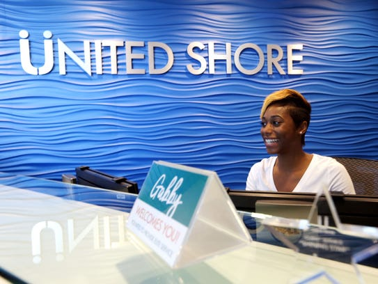 Gabby Christian, talent ambassador for United Shore Financial Services, greets guests at the company's headquarters.