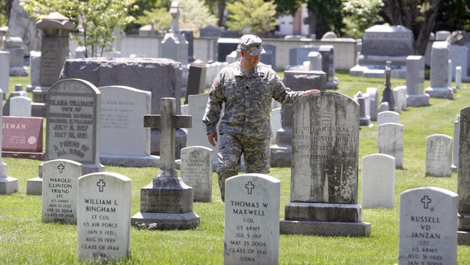 Lt. Col. David Siry, who teaches history at the United States Military Academy at West Point, walks through the West Point Cemetery. Among the notable figures in U.S. military history buried at the cemetery are Lt. Col. George Armstrong Custer, Gen. John Buford, who played a major role in the Battle of Gettysburg during the Civil War, Gen. H. Norman Schwarzkopf Jr., commander of coalition forces in the Gulf War, and Gen. William Westmoreland, who commanded the U.S. forces during the Vietnam War from 1964-68.