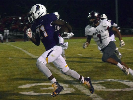 ASH sophomore Bud Clark runs for yards against Pineville