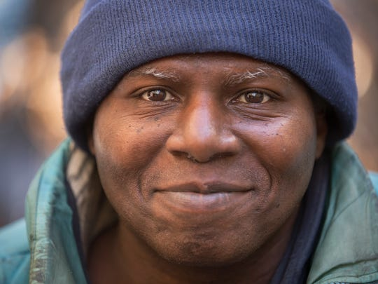 """William 'Willie' Brown, 57, has been living on the streets of downtown Cincinnati since 2003. He's a well-known fixture along 4th street, between Starbucks and Dominos, two businesses he frequents. Brown said he doesn't do drugs or use alcohol. """"I eat, sleep and walk around,"""" he said. He sleeps in an alley near Macy's corporate headquarters on 7th street. Everything he owns, he carries with him, using a push cart. Brown did not attend high school. Chico Lockhart, a social worker with DCI (Downtown Business Inc), who works with the homeless, said Brown won't budge from the streets."""