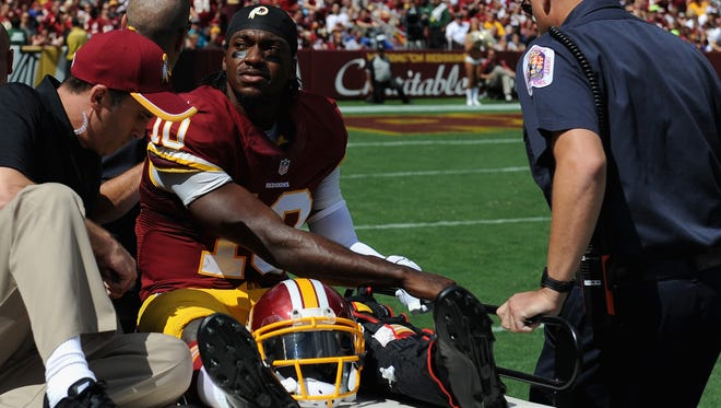 Redskins QB Robert Griffin III is carted off the field Sunday with an ankle injury.