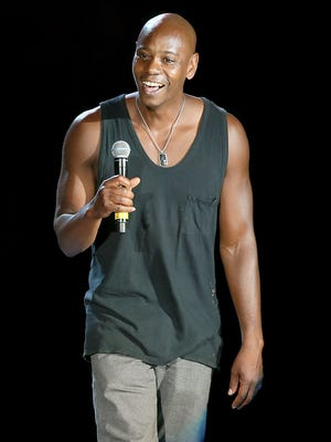 Dave Chappelle performs on stage during the first night of the Oddball Comedy & Curiosity Festival Tour in Austin on Aug. 23.