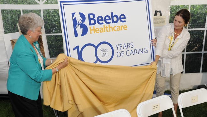 A new sign is unveiled as Beebe Healthcare held their 100th Anniversary Kick Off Celebration on Wednesday September 30th at the main campus on Savannah Road in Lewes.