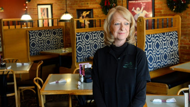 """Jan Wolever says she """"comes with the building"""" when talking about how long she's worked at the Gavel located on Cochran Street in Charlotte for 35 years. The restaurant will close Dec. 31, ending a 32-year run under owners Tom and Sherie Hewitt and will reopen in March as The Dolson. Wolever is pictured in the dining area of The Gavel Thursday Dec. 29, 2016 in Charlotte. She said she is staying on with the new owners."""