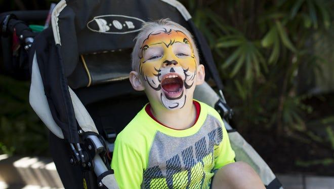AJ Zabish, 3, roars like a tiger at the San Diego Zoo.
