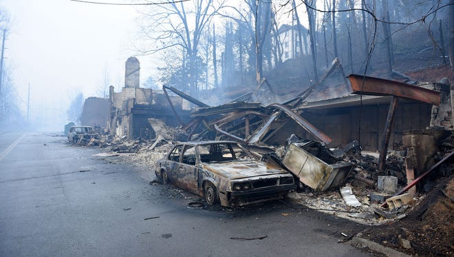 The Nov. 28, 2016, wildfires burned multiple businesses and vehicles like these along Cherokee Orchard Road in Gatlinburg, Tenn.