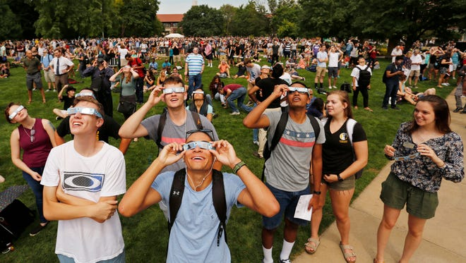 A  large crowd gathered in the Purdue Memorial Mall on Aug. 21 to observe the solar eclipse.
