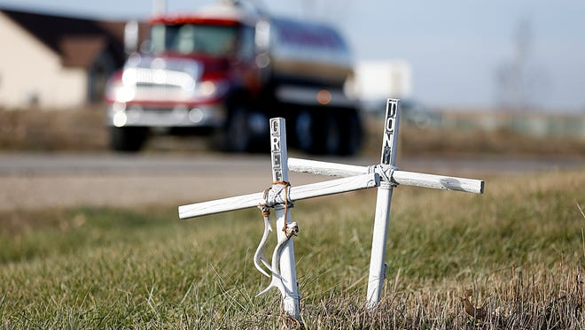 Two makeshift crosses are placed along State 26 in Dodge County, where a fatal crash had occurred.