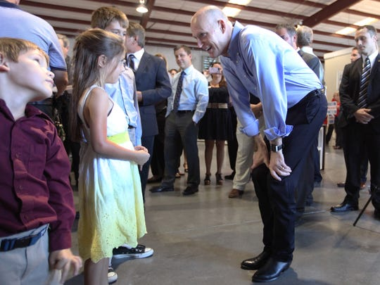 Serenity Francioni, 7, talks with  Scott during a campaign stop.