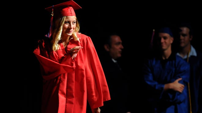 Roy C. Ketcham High School graduate Kaylee Cirrincione waves to well-wishers as she walks the stage to receive her diploma at commencement on Saturday in the City of Poughkeepsie.