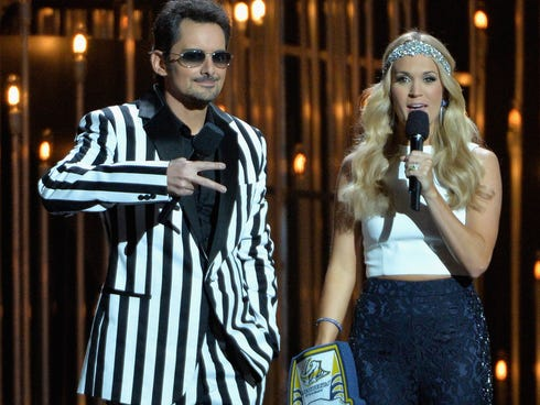Hosts Brad Paisley  and Carrie Underwood speak during the 47th annual CMA awards at the Bridgestone Arena on Nov. 6 in Nashville.