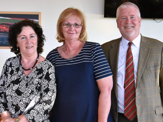 Diane Candido, center, joined by her unit manager Brenda Murrell and Schuyler Hospital President Jim Watson, was recently honored for 45 years of service at Seneca View skilled nursing facility.