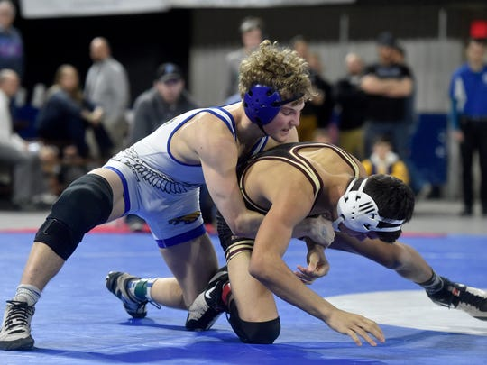 Lewistown's Caleb Birdwell, left, is a two-time state champion who is unbeaten in his high school career. He has two years of high school remaining.