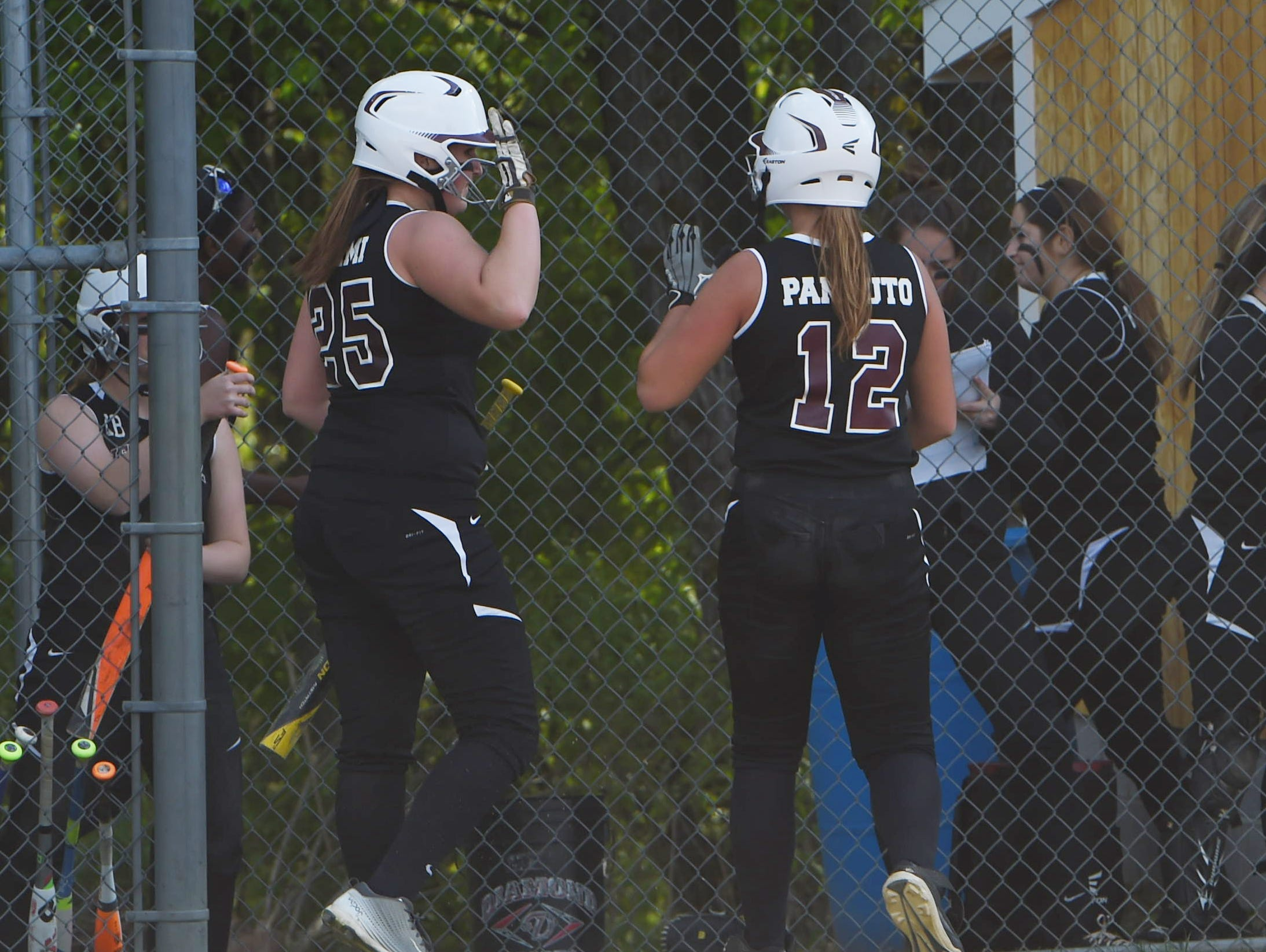 New Paltz's Adriana Crimi and Ally Pannuto go for a high-five during Monday's game against Marlboro.