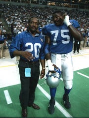 Billy Sims with Lomas Brown before a game against the Cowboys on Sept. 19, 1994.