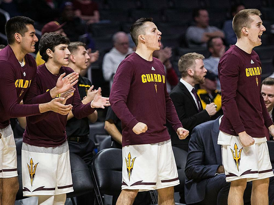 The ASU bench wearing Guard U shirts during the win