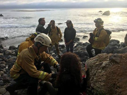 Emergency responders provide aid to Angela Hernandez.