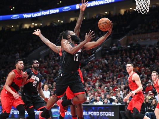 a30fd2267414 NBA  Houston Rockets at Portland Trail Blazers. Rockets guard James Harden  ...