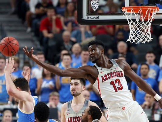 Arizona's Deandre Ayton (13) reaches for a rebound during the second half of the team's NCAA college basketball game against UCLA in the semifinals of the Pac-12 men's tournament Friday, March 9, 2018, in Las Vegas. Arizona won 78-67 in overtime. (AP Photo/Isaac Brekken)