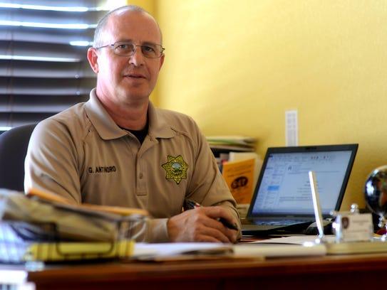 Storey County Sheriff Gerald Antinoro sits at his desk