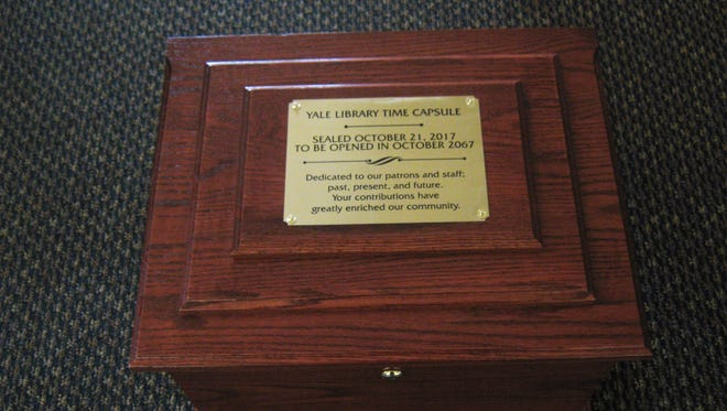 A time capsule was filled and sealed Saturday at Yale Public Library.