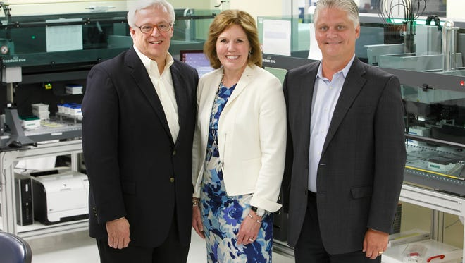 From left: Jim Burns, Gina Drosos and Don Wright of Assurex.