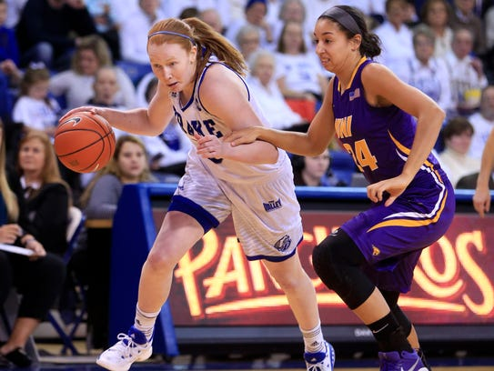 Becca Hittner of Drake drives to the basket as Mikaela