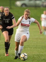 Isabel Stropich of Brighton moves the ball, guarded