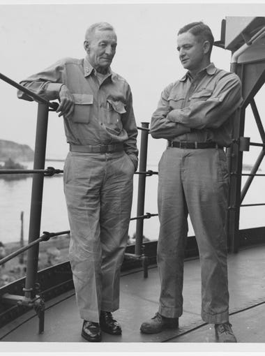 Vice Adm. John S. McCain Sr. with his son, Cmdr. John S. McCain Jr., on board a U.S. Navy ship (probably USS Proteus, AS-19) in Tokyo Bay, circa September 1945. McCain Jr. is father to Arizona Sen. John McCain.