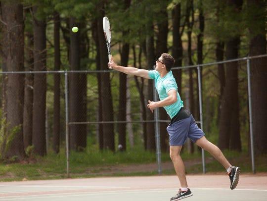 Carl La Barbera returns a shot during Saturday's Vermont