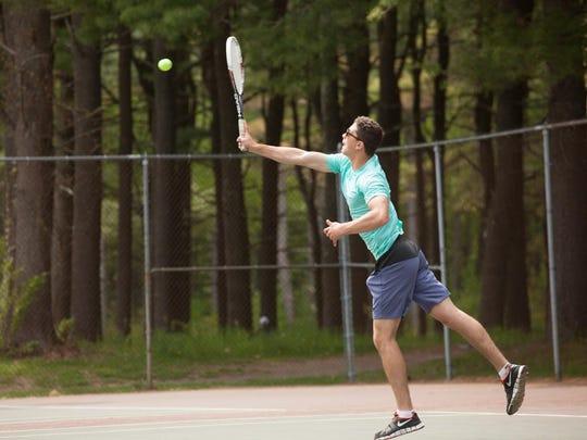 Carl La Barbera returns a shot during Saturday's Vermont high school boys tennis individual state tournament.