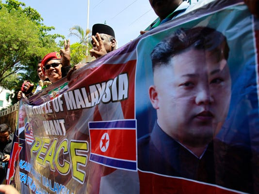 Malaysians protest outside the North Korean Embassy in Kuala Lumpur, Malaysia Friday, March 10, 2017. They were protesting the rising tensions between Malaysia and North Korea following the killing of Kim Jong Nam, the half brother of North Korean leader Kim Jong Un, at Kuala Lumpur International Airport on Feb. 13, 2017. (AP Photo/Daniel Chan)