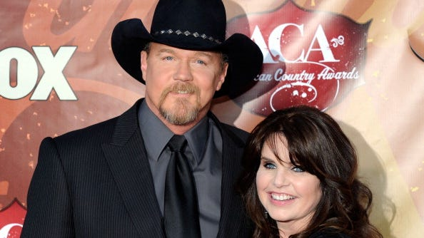 LAS VEGAS, NV - DECEMBER 06:  Singer Trace Adkins (L) and wife Rhonda Adkins arrive at the American Country Awards 2010 held at the MGM Grand Garden Arena on December 6, 2010 in Las Vegas, Nevada.  (Photo by Ethan Miller/Getty Images)