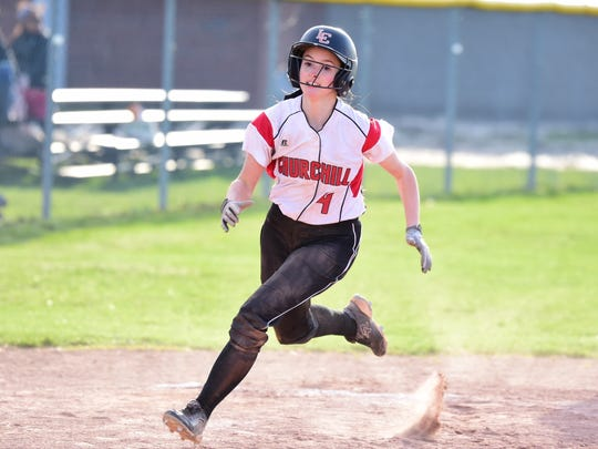 Livonia Churchill junior Paige Hanson comes around to score during the third inning of Wednesday's second game against Plymouth.