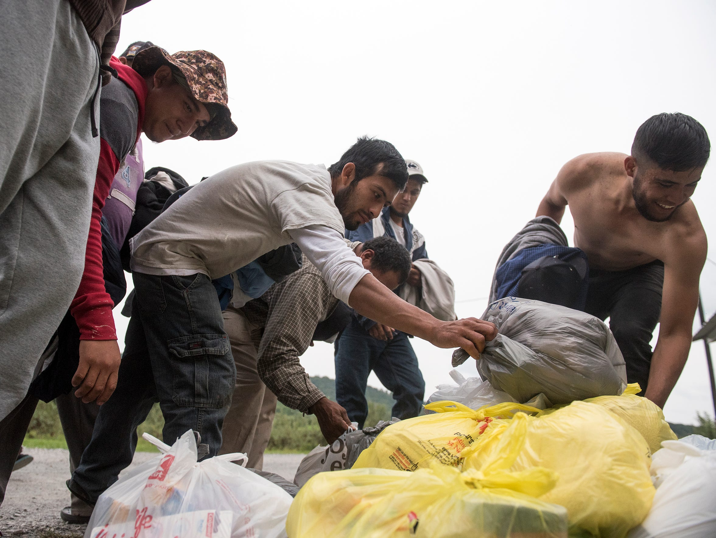 Migrant workers each take a bag of toiletries, which