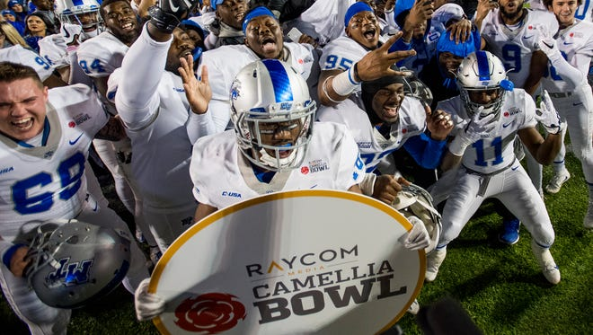 Middle Tennessee State University celebrates winning the Camellia Bowl in Montgomery, Ala. on Saturday December 16, 2017. (Mickey Welsh / Montgomery Advertiser)