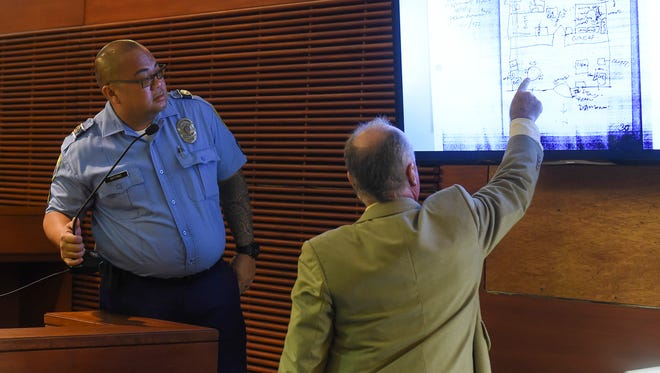 Defense attorney Curtis Van de Veld points at a diagram of Shelly Bernstein's apartment as drawn on the night of her death by Guam Police Department Officer Virgilio Antonio, left, during the murder re-trial of Allan Agababa at the Superior Court of Guam on Sept. 12, 2017.