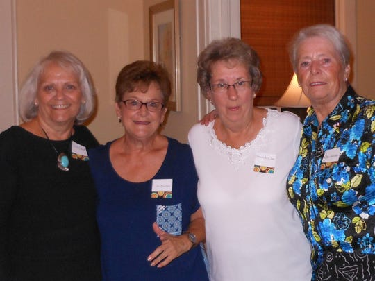 From left, Social VP Cindy Russell, Membership VP Jan Burdette, Bowling and Bunco chairman Sharon McClain, with Olga Aldridge at the International Dinner Festival hosted by the Newcomers Club of Montgomery.