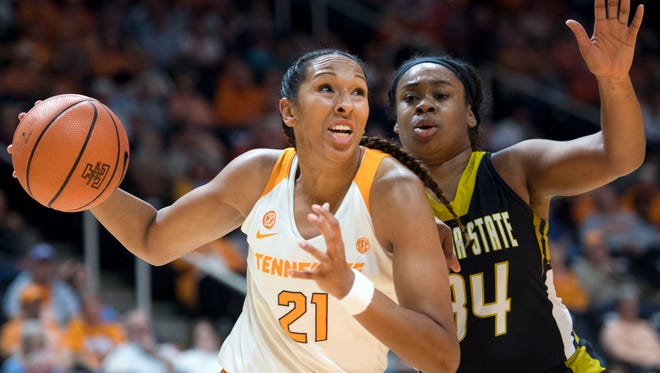Tennessee's Mercedes Russell drives to the basket while being defended by Alabama State's Tatyana Calhoun on Sunday.