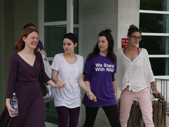 Nicole Addimando, second from left, wearing white t
