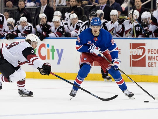 New York Rangers right wing Pavel Buchnevich (89) skates against Arizona Coyotes right wing Mario Kempe (29) during the second period of an NHL hockey game, Friday, Dec. 14, 2018, at Madison Square Garden in New York. (AP Photo/Mary Altaffer)