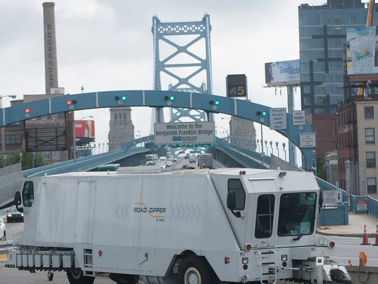 The Delaware River Port Authority Barrier Transfer vehicle, the Zipper machine, is shown on the Philadelphia side of the Ben Franklin Bridge.