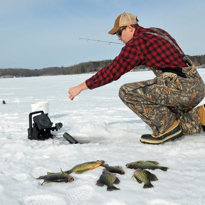 Cody Larsen tries to add to his catch while jigging
