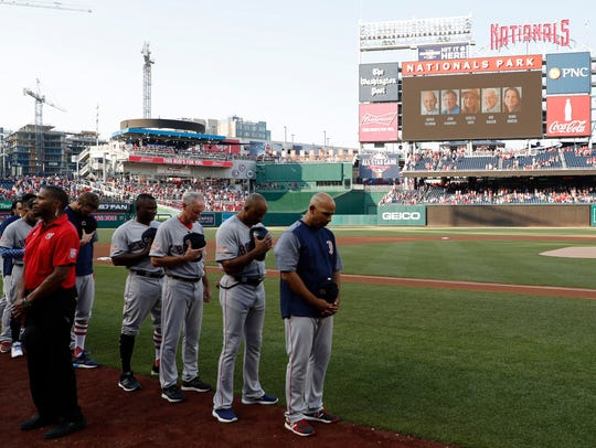 Boston Red Sox players and coaches participate a moment