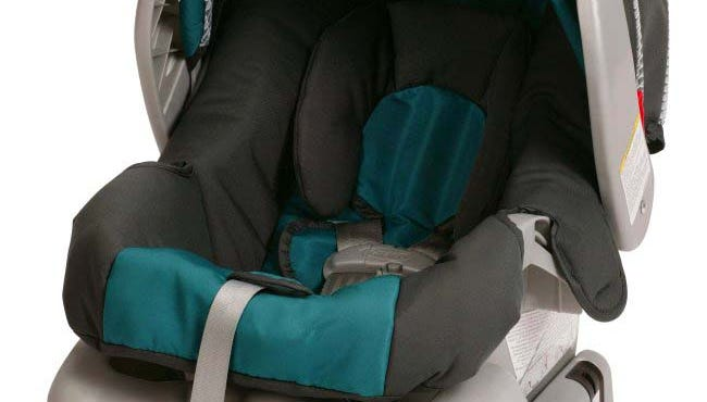 This undated photo provided by Graco Children's Products shows a SnugRide Classic Connect infant car seat.