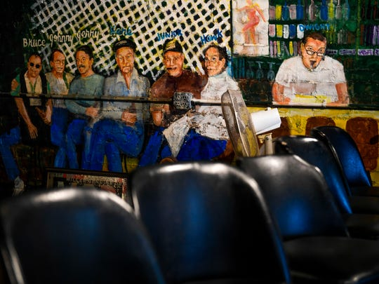 The back wall at Jack's Pool Room is decorated with a mural of eight guys that were both regulars and bartenders at the 89 year-old establishment in Paris, Tenn., Wednesday, July 25, 2018.
