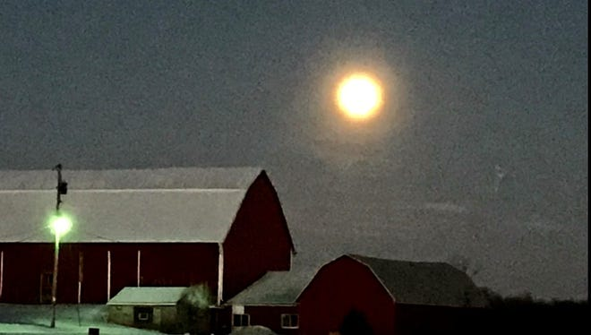 A full moon rises on a bitter cold evening behind a Fond du Lac County farm on Jan. 1, 2018.